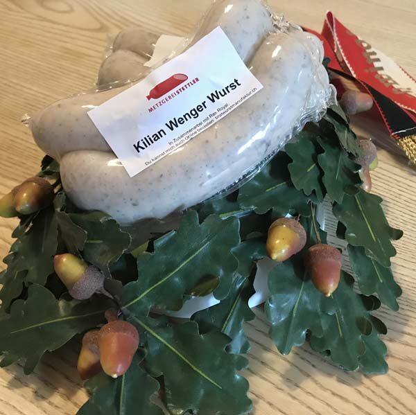 Zu Ehren des Eidgenössischen Schwing- und Älplerfest (ESAF) in Zug wurde in Zusammenarbeit mit dem Schweizer Kaffeemaschinenhersteller Rex Royal für den Schwingkönig Kilian Wenger die Kilian Wenger Wurst kreiert. Auf dem Bild ist der Kranz des eidg. Schwingfest in Frauenfeld abgebildet.